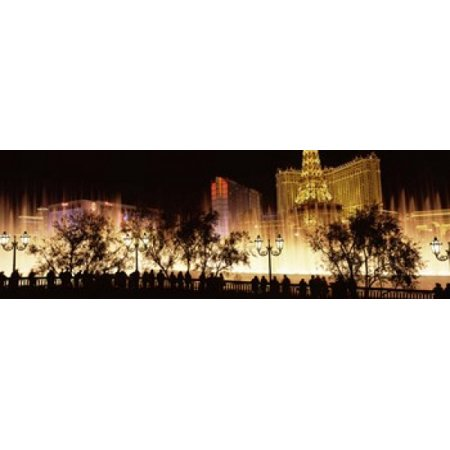Hotels in a city lit up at night The Strip Las Vegas Nevada USA Canvas Art - Panoramic Images (18 x 6)